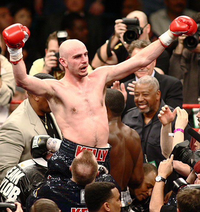 Pavlik celebrates his unanimous-decision victory over Taylor.