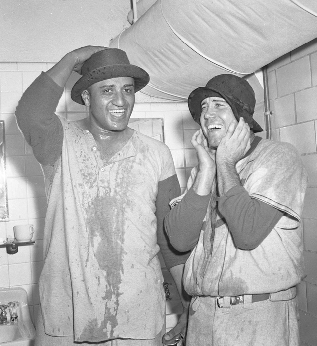 Snider celebrated with Don Newcombe in the Dodgers clubhouse after winning the 1956 National League Pennant. The team would end up on the losing end of a seven-game World Series against the Yankees.
