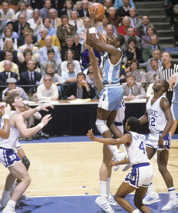 Jordan takes a shot in the lane amid a sea of Tar Heel defenders. Jordan won the Naismith and the Wooden College Player of the Year awards in 1984 before being drafted by the Bulls with the third overall pick.