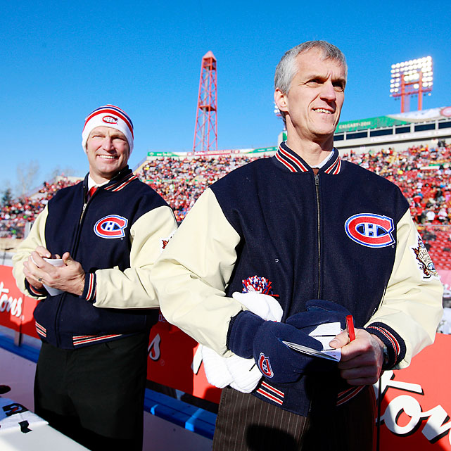 Canadiens assistant coach Kirk Muller and video coach Mario Leblanc get set to brave the elements behind the bench.