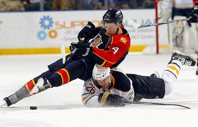Keaton Ellerby (4) of the Florida Panthers collides with Thomas Vanke (26) of the Buffalo Sabres while racing for the puck at the BankAtlantic Center in Sunrise, Fla., on Feb. 10. The Sabres outlasted the Panthers 3-2 in overtime.