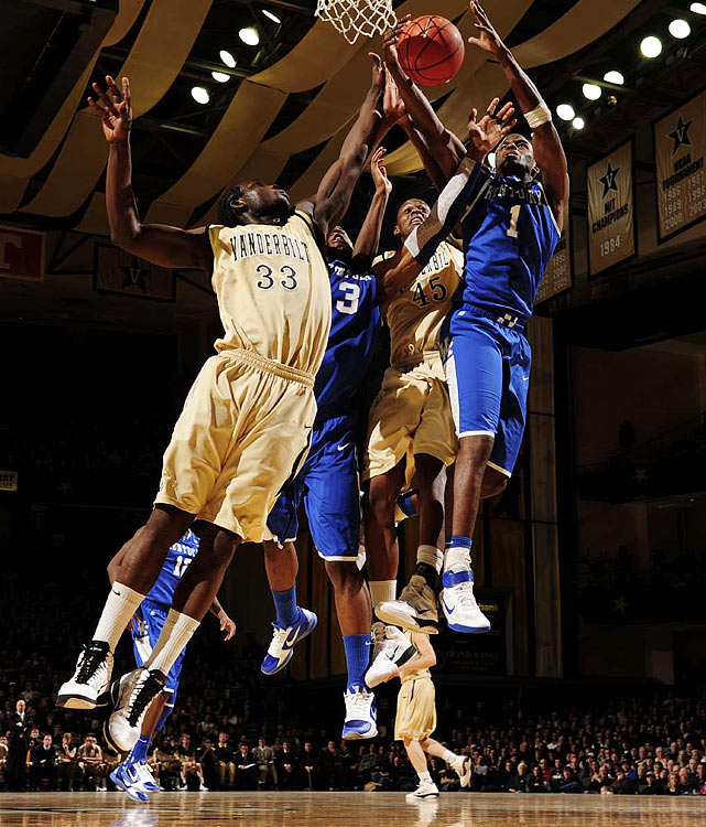 Darius Miller (1) and Terrence Jones (3) of the Kentucky Wildcats fight for a rebound against Steve Tchiengang (33) and Rod Odom (45) of Vanderbilt. The 23rd-ranked Commodores held off No. 18 Kentucky 81-77 on Feb. 12 at Memorial Gym in Nashville.