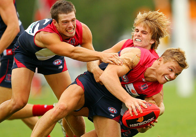 Colin Sylvia is tackled during the Melbourne Demons AFL Intra Club match at Gosch's Paddock on Feb. 3 in Melbourne.