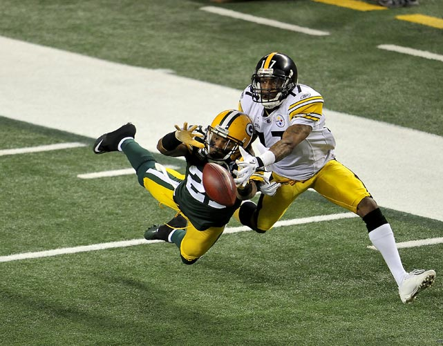 Green Bay's Charles Woodson breaks up a pass intended for Mike Wallace during Super Bowl XLV. Woodson broke his collarbone in the first half and didn't return.