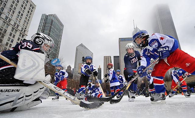 Six-year old Tyler Pan (right) tries to score on goalie Hunter Vaughn, 8, during a youth hockey clinic as part of a Hockey Day in America event at Millenium Park on Feb. 20 in Chicago. The National Hockey League and NBC sponsored the event.