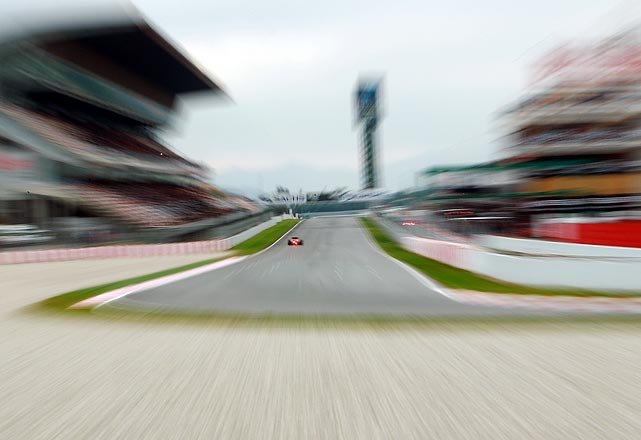 A driver speeds past the grandstand during Formula One car testing at the Circuit de Catalunya in Barcelona, Spain.  The first race of the 2011 season, the Bahrain Grand Prix, has been canceled following civil unrest, with the championship rescheduled to begin at the Australian Grand Prix in March.