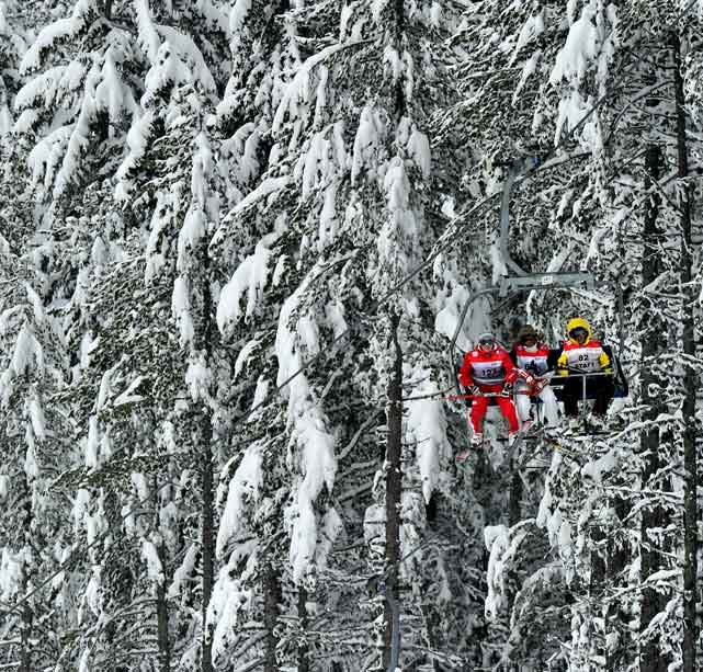 A course official takes a lift during the FIS World Cup in Bansko on Feb. 26.