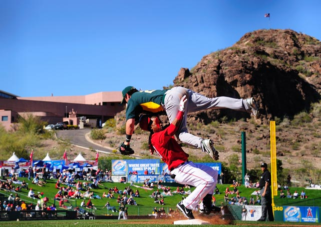 Andy LaRoche of the Oakland Athletics goes airborne while making a play  against the Los Angeles Angels of Anaheim on Feb. 28 in Tempe. The Angels won 8-7.