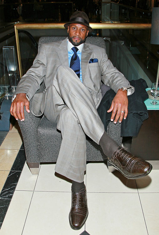 The former NBA player took a break from Magic Johnson's private shopping event at Nordstrom in L.A. Seems the man needs a bigger chair.