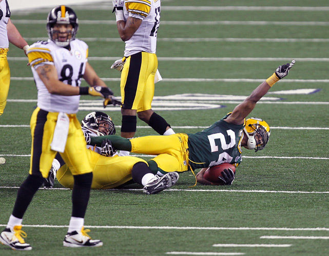Green Bay defensive back Jarrett Bushhits the turf after picking off Ben Roethlisberger during in the second quarter.