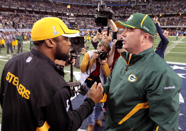 Minutes before Super Bowl XLV kicked off at Cowboys Stadium, Steelers coach Mike Tomlin and Packers coach Mike McCarthy met at midfield to exchange pleasantries. It would be the last time Pittsburgh and Green Bay were friendly to one another Sunday before taking part in one of the most exciting Super Bowls in recent memory. MVP Aaron Rodgers and the Packers survived a late rally from the Steelers to claim a 31-25 victory and the franchise's 13th NFL title and fourth Super Bowl championship, their first since Super Bowl XXXI.  With 11 Sports Illustrated photographers among the thousands of media members in Arlington, Texas this week, here are our best photos from Super Bowl XLV in chronological order.