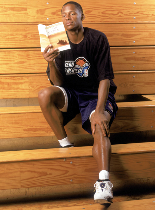 Allen, who dedicates time to the NBA's Read To Achieve Program, relaxes with a book.