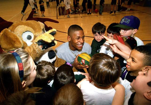 Allen was drafted fifth overall by Minnesota in 1996 and was promptly traded to the Bucks along with Andrew Lang for Stephon Marbury.  In this photo, Allen is seen spending quality time with a group of young Bucks fans.