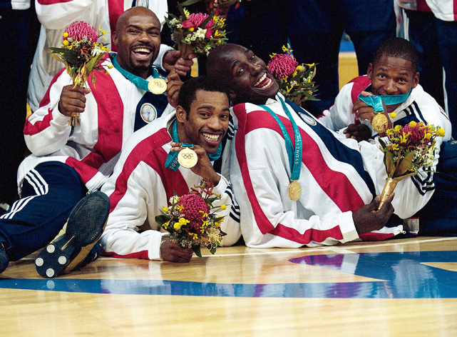 Allen, along with teammates Tim Hardaway, Vince Carter and Kevin Garnett, shows off his gold medal.