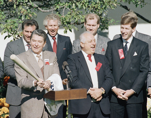 President Reagan holds a bat given to him by members of the 1988 World Series Champion Los Angeles Dodgers.