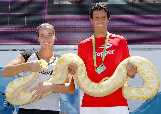 Jarmila Groth of Australia and Juan Ignacio Chela of Argentina hold a snake from the Miami Metro Zoo during the 2011 Sony Ericsson Open in Key Biscayne, Fla.