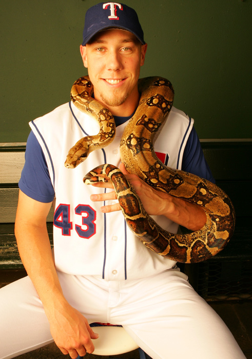 Texas Rangers pitcher Kameron Loe poses with his pet snake Angel.