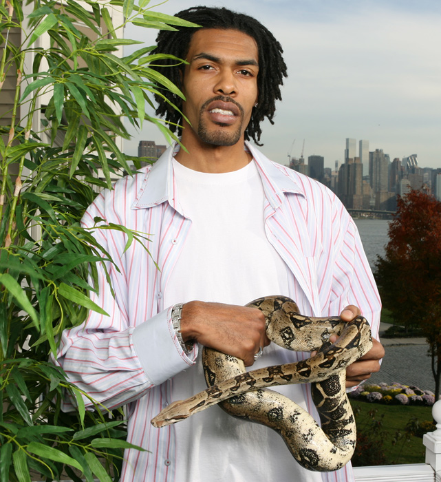 Mikki Moore, who played with 10 teams over his 13-year career,  shows off his pet alligator and snake during a 2006 SI photo shoot.