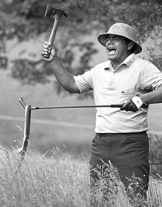 Lee Trevino takes a hatchet to a snake he found in his bag during a practice round before the 1971 U.S. Open.