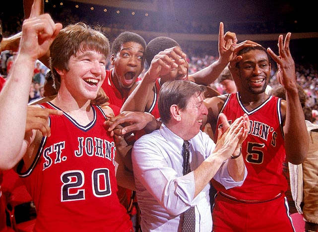 St. John's coach Lou Carnesecca celebrates with Chris Mullin (20) and Billy Goodwin (35) after winning the Big East championship against Boston College. The 1983 Big East tourney was the first of many held at Madison Square Garden.
