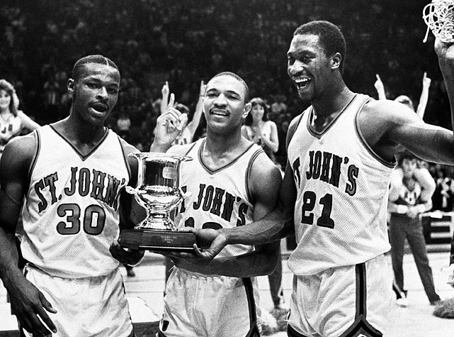 St. John's stars Willie Glass (30), Mark Jackson (13) and Walter Berry (21) hoist the trophy after their last-second, 70-69 victory over Syracuse to win the 1986 Big East tournament. The Red Storm would not win another Big East tournament until the 1999-2000 season.