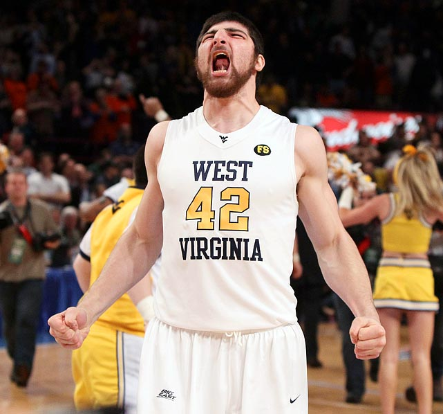 Deniz Kilicli screams in triumph after West Virginia defeated Georgetown 60-58 in the Big East championship. The conference championship was a first for the Mountaineers and they proceeded to advance to the Final Four in the NCAA tourney.