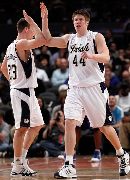 Notre Dame forward Luke Harangody (44) high-fives teammate Ben Hansbrough during a 68-56 victory over Seton Hall.