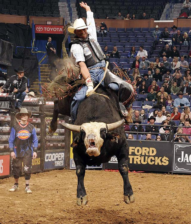 Elton Cide of Populina, Brazil rides Blind Side for 85.5 points  in Round 1 at the Scottrade Center in St. Louis.