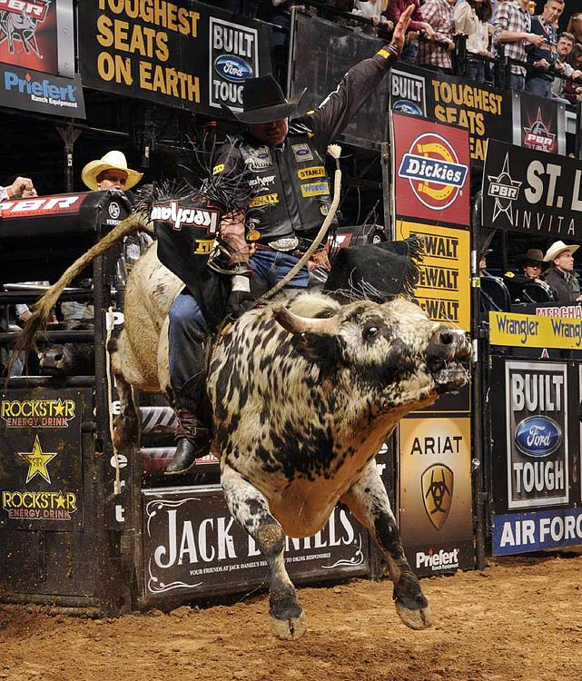 Guilherme Marchi of Leme, Brazil rode Priceless for 90.5 points in the Built Ford Tough Championship Round to win the Professional Bull Riders St. Louis Invitational at Scottrade Center.   St. Louis was the eighth stop on the nationally-televised BFTS, which makes 28 stops in 23 states. SI's David E. Klutho photographed the event.