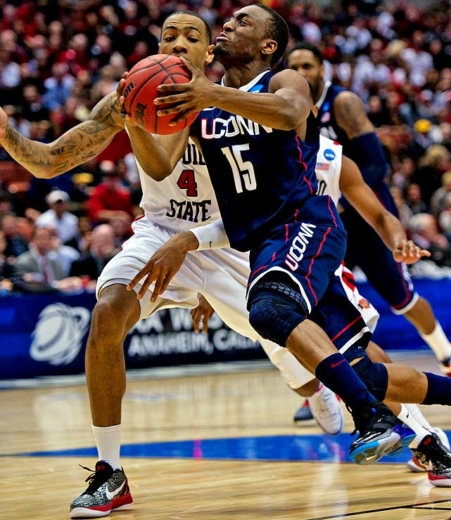 Kemba Walker sliced up San Diego State's defense for 22 points on shots from all angles and distances in the second half of Connecticut's West regional semifinal.  Walker scored 36 points in yet another dynamic postseason performance, driving UConn down the stretch to a 74-67 victory.