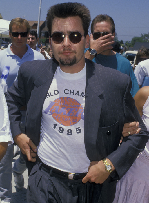 Sheen arrives at the 1988 Los Angeles Police-Celebrity Golf Tournament showing his love for the Lakers.
