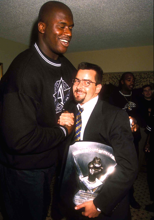 Sheen greets Shaquille O'Neal at the 1991 opening of the All-Star Cafe in Times Square.