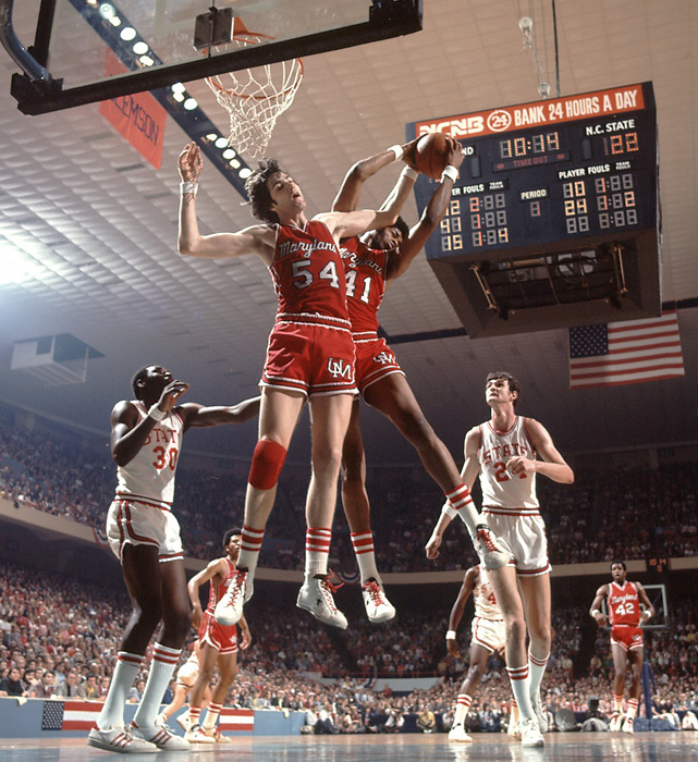 Tom McMillen (54) and Len Elmore of Maryland rebound during the championship game against N.C. State. Elmore is the Terps'  all-time leading rebounder.