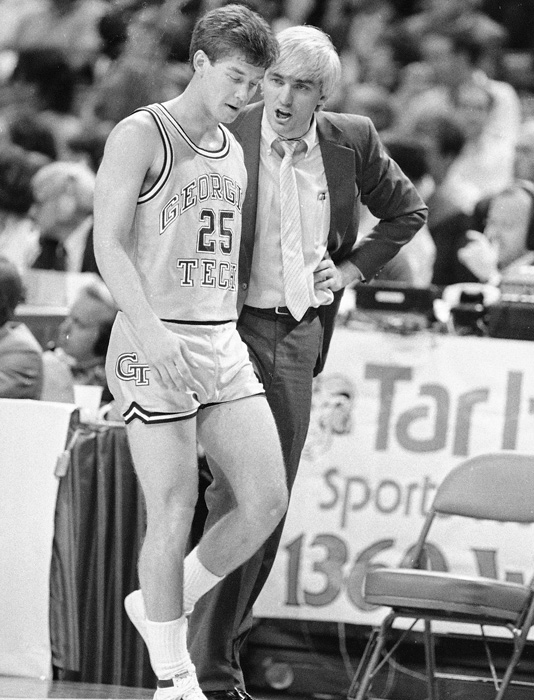 Georgia Tech's Mark Price listens to coach Bobby Cremins during a game against Duke.