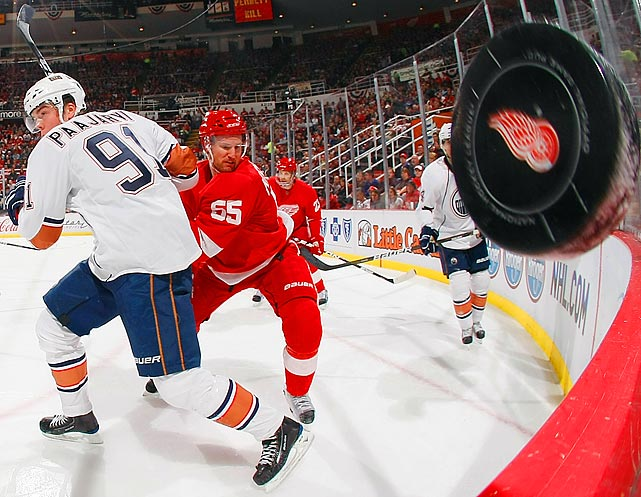 Detroit Red Wings defenseman Niklas Kronwall and Edmonton Oilers leftwinger Magnus Paajarvi search for the puck during the Red Wings 2-1 victory over the Oilers at Joe Louis Arena in Detroit.