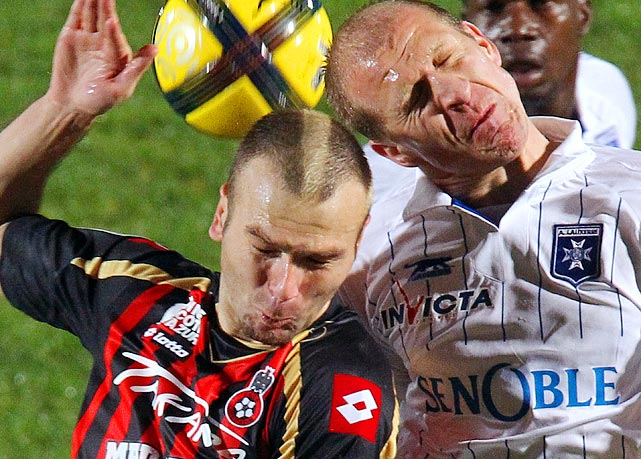 OGC Nice forward Danijel Ljuboja (left) butts heads with AJ Auxerre's Stephane Grichting during their Ligue 1 match at Ray Stadium in Nice, France.  OGC Nice would go on to win 1-0.