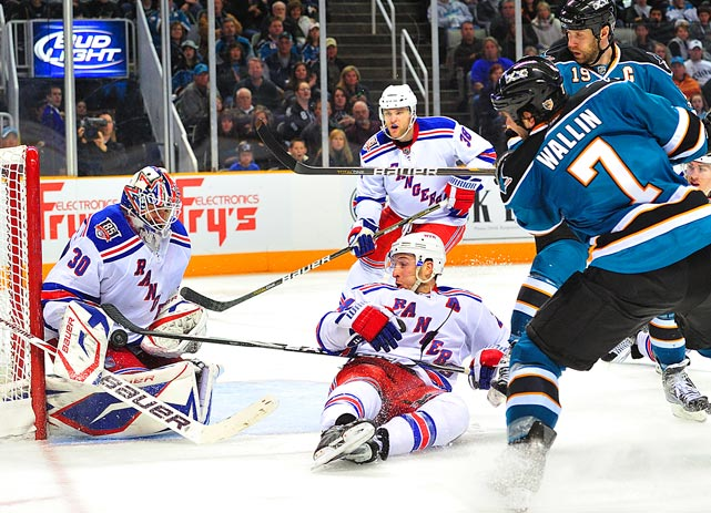 New York Rangers goalie Henrik Lundqvist makes a save against the San Jose Sharks during the third period at HP Pavilion in San Jose, Calif., on March 12. New York defeated San Jose 3-2 in shootouts.