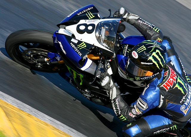 Professional road racer Josh Herrin leans into a turn during the Daytona 200 motorcycle race at Daytona International Speedway in Florida.