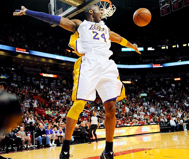 Los Angeles Lakers star Kobe Bryant stretches for a reboundduring the Lakers' 94-88 loss at the Miami Heat on March 10.  The victory snapped a five-game losing streak for the Heat.