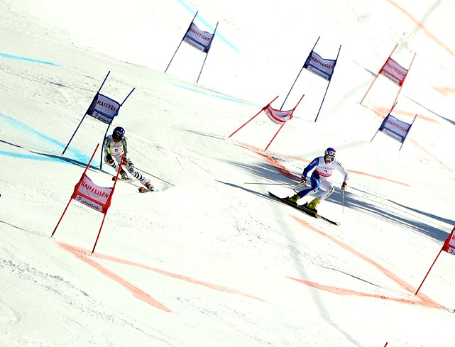 Germany's Felix Neureuther (left) races against Italy's Manfred Moelgg during the final of the team event at the Alpine Ski World Cup finals in Graubunden, Switzerland. Germany and Neureuther would win the team event.