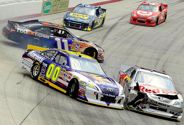 David Reutimann (00) collides with Brian Vickers (83) and Denny Hamlin (11) during NASCAR's Sprint Cup Series race at Bristol Motor Speedway.