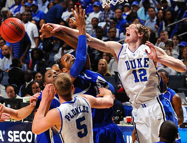 Duke forward Kyle Singler (12) loses the ball against Hampton during their NCAA tournament game.  Duke, which never trailed in the game, would beat Hampton 87-45 to advance to the round of 32.