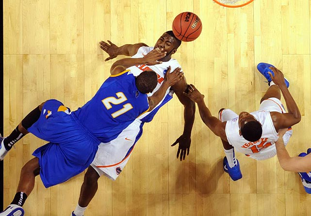 UC Santa Barbara's James Nunnally seems to hold down a Florida player during the team's second-round match in the NCAA tournament.  Short of holding Gators down, the Gauchos didn't have much of a prayer during their 79-51 defeat.