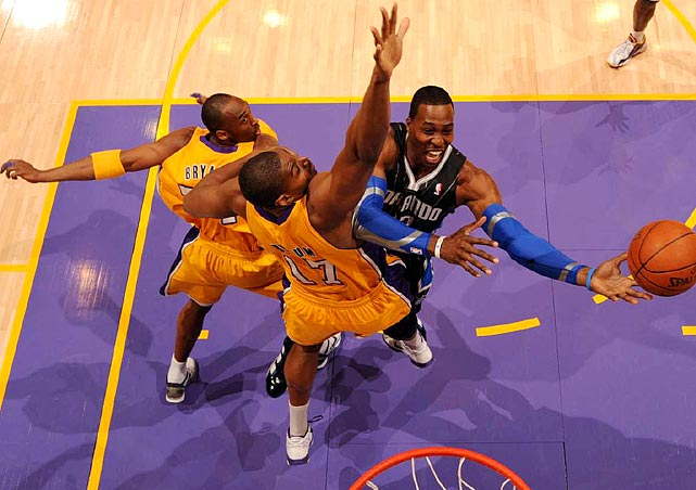 Orlando Magic center Dwight Howard spins away from the Los Angeles Lakers' defense during the Magic's 97-84 loss in Los Angeles.