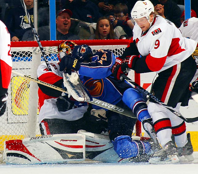 Atlanta Thrashers winger Andrew Ladd collides with Ottawa Senators goalie Craig Anderson during the Thrashers 5-4 shootout victory at Philips Arena.