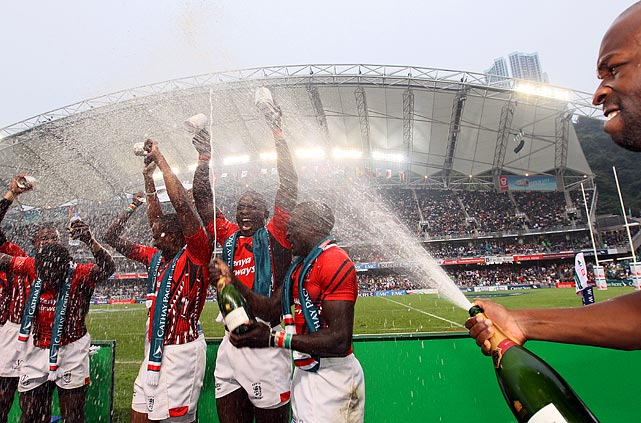 The Kenyan team celebrates defeating Spain at the IRB Sevens World Series by popping bottles.