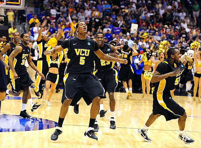 Virginia Commonwealth forward Juvonte Reddic and the rest of the Rams go crazy after upsetting Kansas to advance to the first Final Four in VCU history.  VCU, an 11 seed, joins George Mason (2006) and LSU (1986) as the lowest seeded teams to ever reach the Final Four.