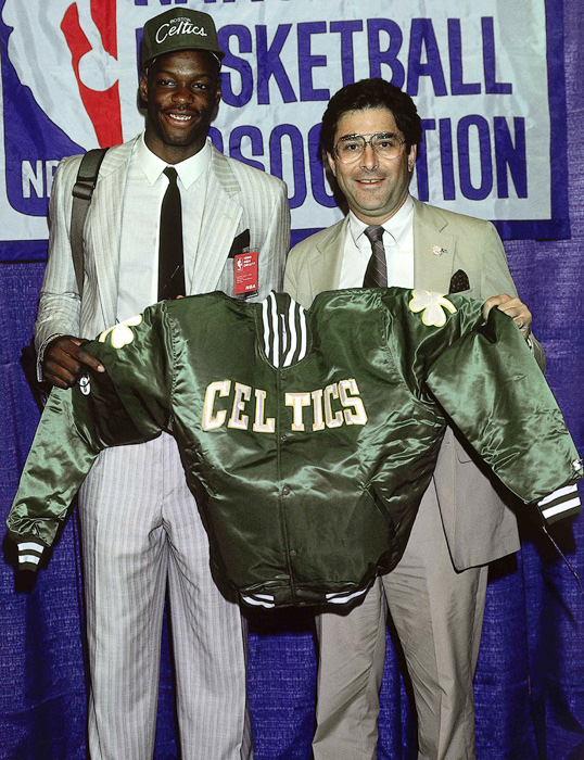 Bias poses with a metallic green Celtics jacket moments after being selected with the second overall pick. There's no telling how many more banners the Celtics could have added to the rafters had Bias played.