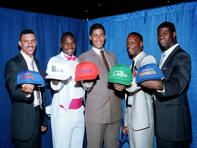 The top five overall picks from the 1986 NBA draft smile as they flaunt their respective team caps. From left to right are Ken Walker, Chuck Person, Brad Daugherty, Bias, and Chris Washburn.