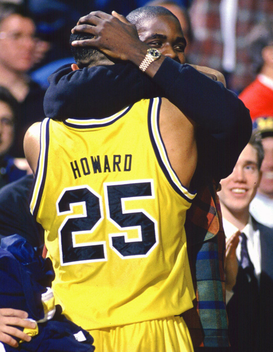 The Wolverines started the season at 11-4 before winning nine straight Big Ten games to finish with a 21-7 record. Though the team was without Webber (seen here hugging Howard after a home game at Crisler Arena), it secured a No. 3 seed in the NCAA tournament and advanced to the Elite Eight, where it was knocked out by Arkansas.